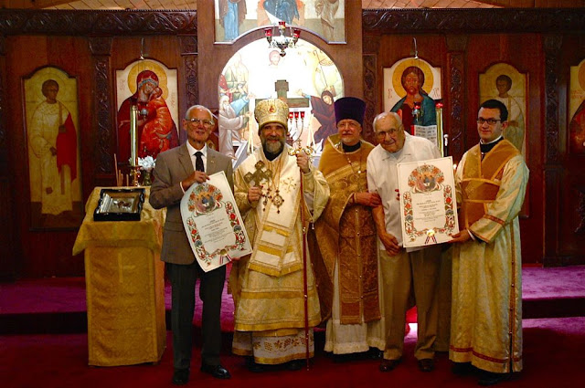 Vladyka with Fr. John and the gramota recipients, Peter and Charles.