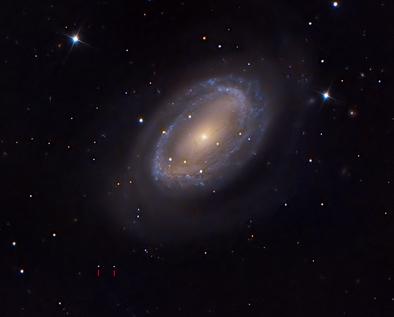 NGC 4725 e Makemake