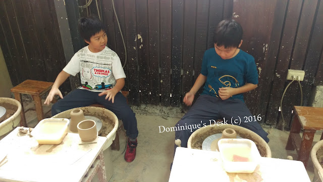 The boys at the pottery wheels