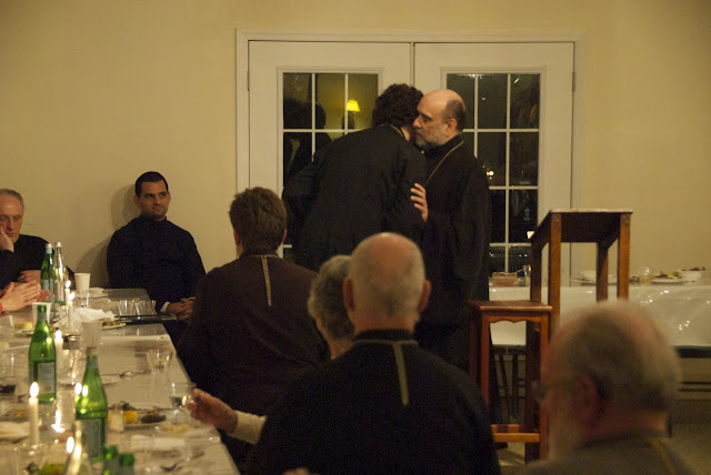 Bp. Michael embraces new priest and DDB beneficiary Fr. Matthew Markewich.