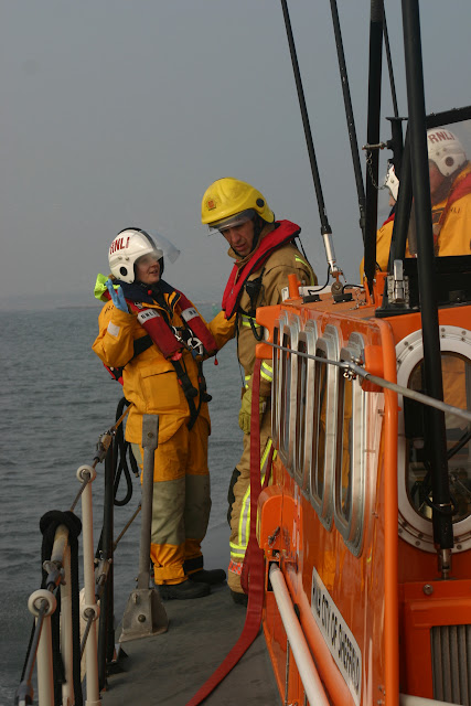 2011, 27 March – Poole lifeboat Crew Member Natalie Warren providing Dorset Fire and rescue with details of the training incident