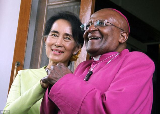 Anti-Apartheid campaigner Desmond Tutu (right) has condemned Burma's Aung San Suu Kyi (left) for her silence on the ethnic cleansing of Muslims in her country. Photo: AP