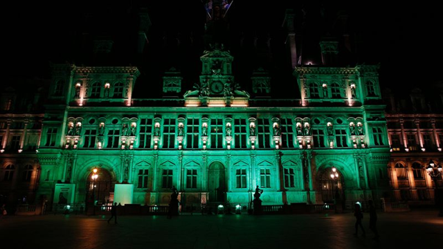 A picture taken on 1 June 2017, shows the City Hall of Paris illuminated in green following the announcement by US President Donald Trump that the United States will withdraw from the 2015 Paris accord and try to negotiate a new global deal on climate change. Source: Photo: Geoffroy Van Der Hasselt / Getty Images