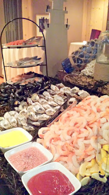 Heathman Beaujolais Nouveau 2015 Northwest Seafood station bursting with poached prawns, steamed clams and mussels and smoked salmon and poached salmon, as well as oysters shucked expertly before you