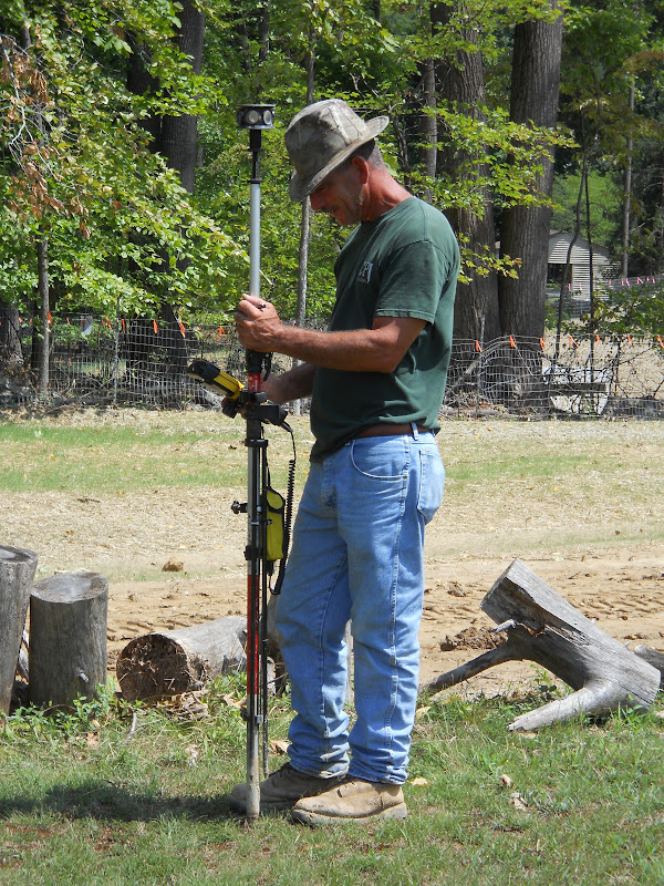 A surveyor with his instruments