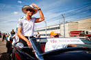 Jenson Button with hat in the driver parade.