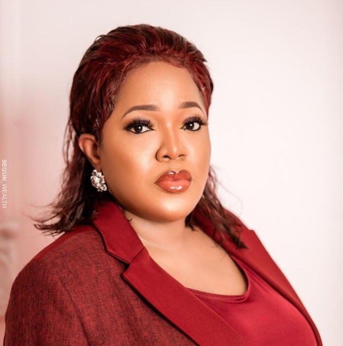 Toyin Abraham wore a red Tiannah Empire styled suit to the Sound City MVP Awards (photos)