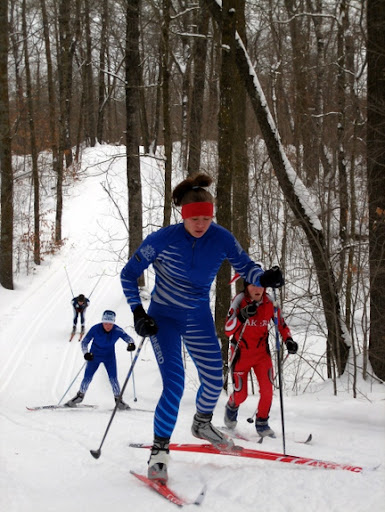 Girls varsity skiers in classic race.
