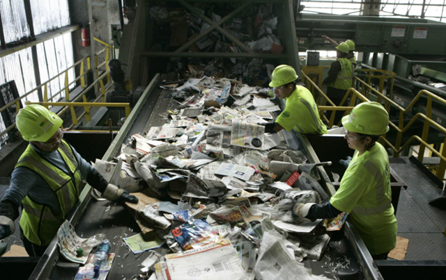 Workers at a recycling plant in Newark, New Jersey. Photo: Mike Derer / AP Photo