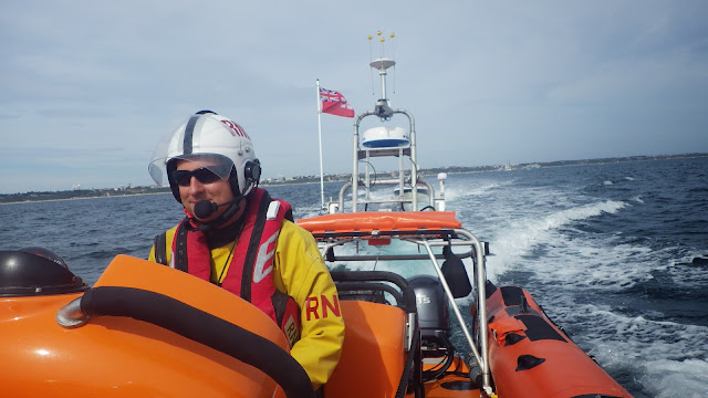 Helmsman Dave Riley looking as if he's concentrating! 1 September 2013 Photo: RNLI/Poole