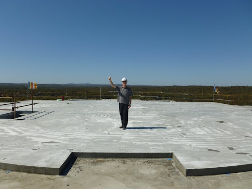 Ian Green stands atop the concrete slab at level 6 of the Great Stupa of Universal Compassion,Victoria, Australia.