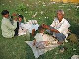 Amarpurkashi children get their hair cut.