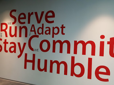 Garena's manifesto lists several core values which are featured in every function room as well as on this feature wall.