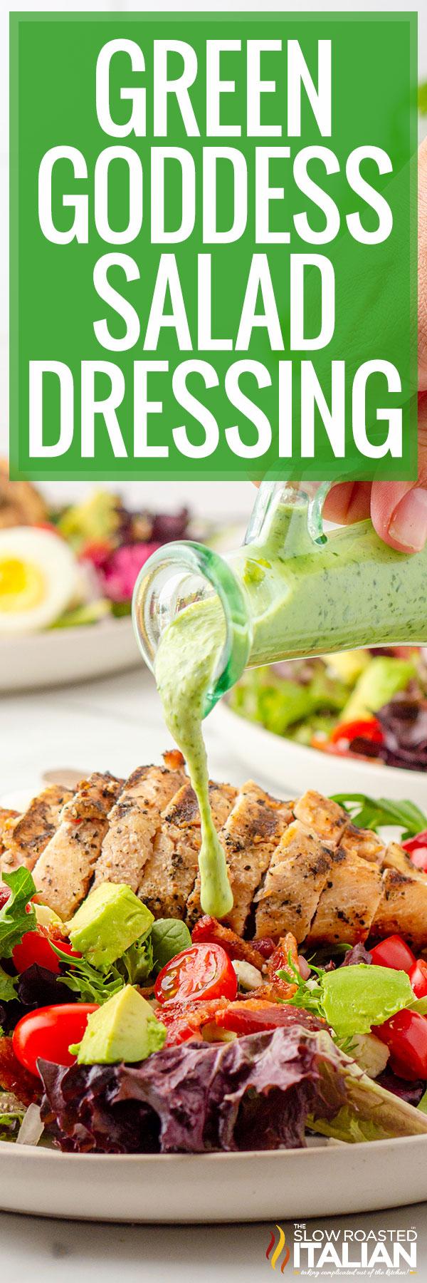 Green goddess salad dressing poured over a salad