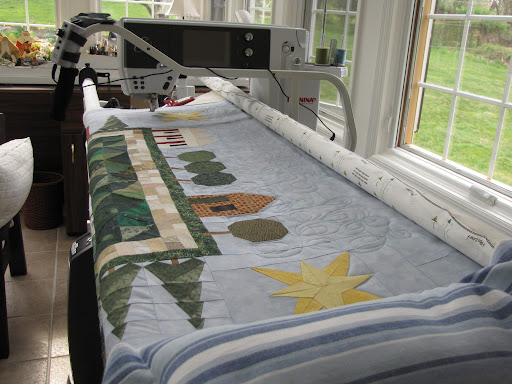 A long-arm machine for quilting the big stuff - one quilt is usually on this while another is being quilted by hand.