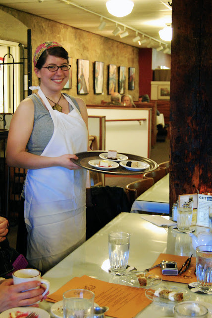 Allie, the baker at Colophon Cafe in Fairhaven, presents a sampling of local favorite desserts.  Credit: Bellingham Whatcom County Tourism