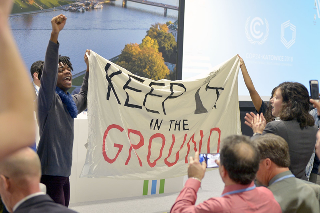 Protesters at the UN climate talks in Poland disrupt a U.S. panel on coal power with chants of 'Keep it in the ground' and 'Shame on you', 10 December 2018. Photo: Lukasz Kalinowski / REX / Shutterstock