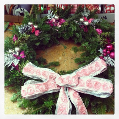 handmade wreath with pink and glitter decorations like the tori amos song