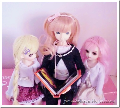 Some ball jointed dolls enjoying a book.  Reading is for everyone.