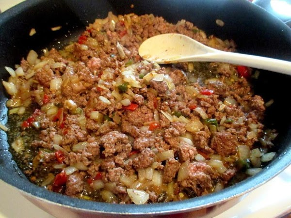 Now, crumble the ground beef into the skillet and cook until no longer pink....