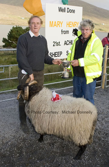 Michael J Corrigan (on right) presents the Martin Corrigan Perpetual Cup to Martin McGlynn for best Hogget Ram (confined) at the 21st Achill Sheep Show (Taispeántas Caorach Acla 2007) at Johnny Pattens Bar, Derreens Achill. Photo: © Michael Donnelly