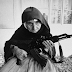 A 106-year-old Armenian woman guarding her home with an AKM, 1990.
