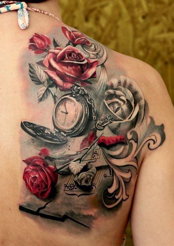 folhas_de_msica_rosas_e_relgio_de_bolso_de_trs_da_tatuagem