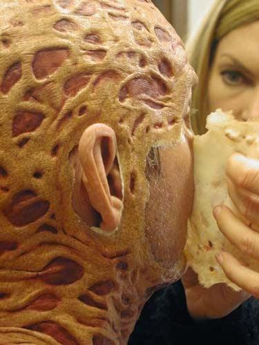Make-up artist Margaret Yaworski applying Freddy's cheek piece.