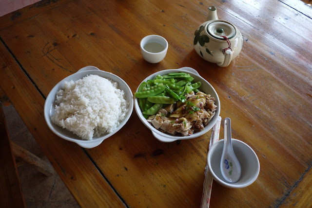 dish of chicken and snow peas next to a large bowl of rice