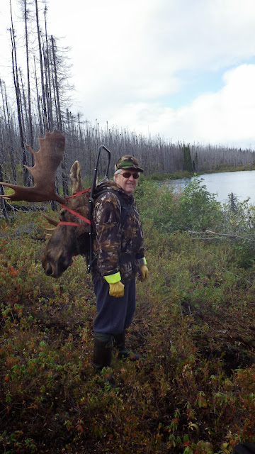 Claude with the head of the bull Moose killed in 2012