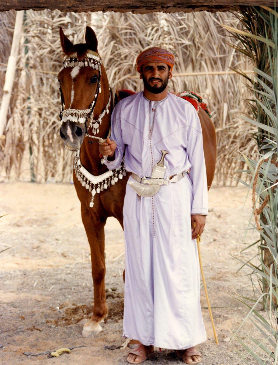 Oman - man in dishdasha gown, muzzar turban and khanjar knife