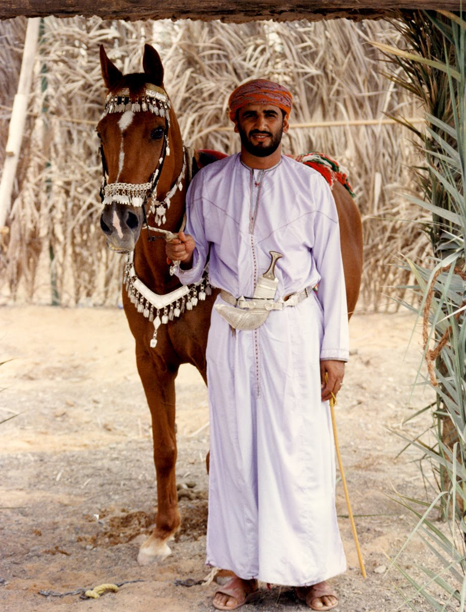 Oman - man in dishdasha gown, muzzar turban and khanjar knife