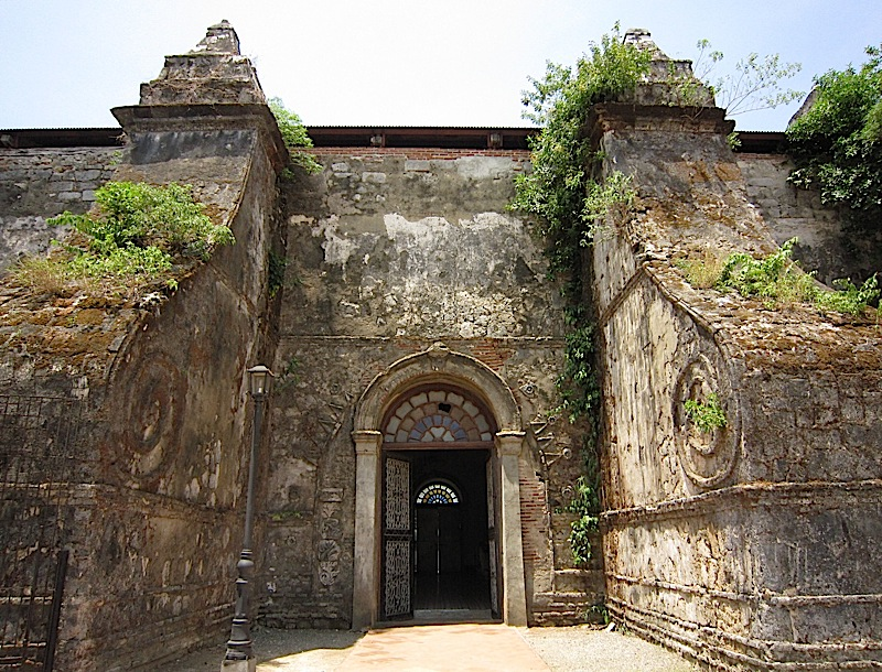 side door between two buttresses of the Paoay Church
