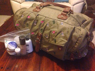 Packed holdall and toiletries in clear bag