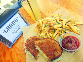 From Lardo, the Jenn Louis chefwich, a grilled cheese with fontina cheese, plum conserva on Grand Central Bakery sour rye. Also, Lardo Fries and Lardo's Kentucky Lemonade