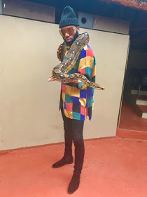 Fashion Stylist, Swanky Jerry Plays With Snakes And Lions In SA (Photos)