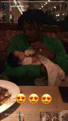 Singer Runtown bottle feeding his son