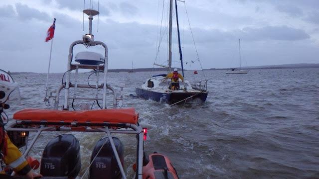 ILB tows the stricken catamaran towards Rockley - 24 December 2013.  Photo credit: RNLI/Poole