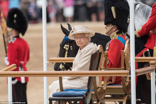 Sitting in front of ranks of the Household Division, the Queen and Prince Philip take part in the annual Trooping of the Colour parade.jpg