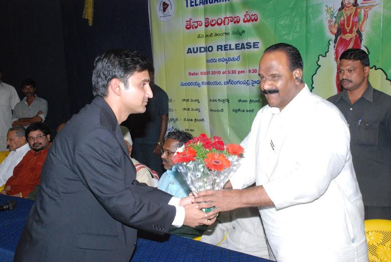 TeNA coordinator Sai swaroop Thota presenting bouquet to Nayini Narsimha Reddy