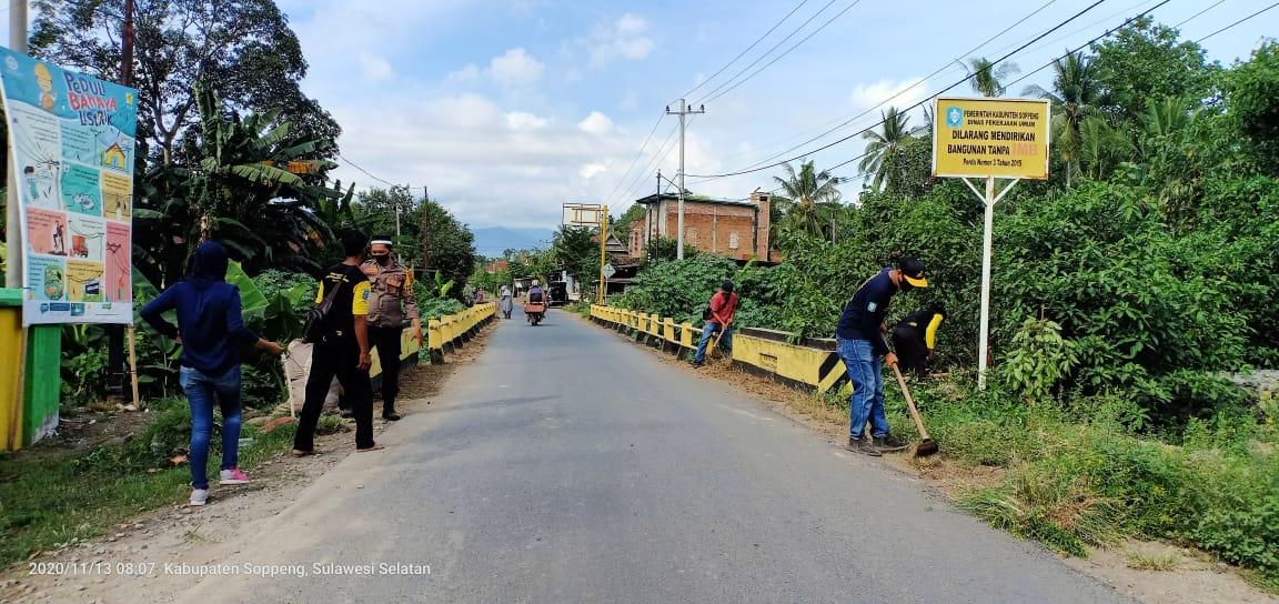 Bhabinkamtibmas Polsek Ganra Gelar Kerja Bakti Bersama Aparat Desa Belo
