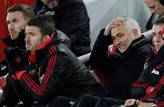 Manchester United manager Jose Mourinho reacts as assistant coach Michael Carrick witnesses a shocking defeat by Liverpool at Anfield on Sunday afternoon.