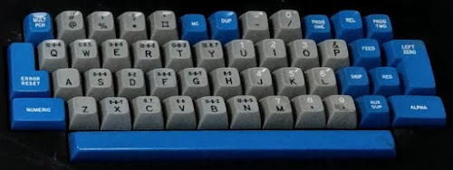 "Keyboard of an IBM 029 keypunch. ""Numeric"" key is in the lower left. Strangely, this keyboard labels most special characters with the holes that are punched (e.g. 12-8-6) rather than the character. Compare with the photo of a different 029 keyboard later."
