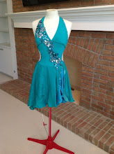 Photo: To buy ( MBCan-RHUMBA  ) reference name of costume, size, qty needed and copy/past photo to Pam@Act2DanceCostumes.com      $ 125.00  qty (1)   Sizes: (1) Adult Med  RHUMBA-the flowing skirt, side slit to hip and low back accentuate the sensuous nature of this dance. Teal green lined halter leotard with matching double layer SILK chiffon   skirts. The back is low and sides cut on curve. There is a single mid back thin teal strap. Light beige mess on the open lower back  Teal and silver appliques accented with blue zircon swarovski crystals across torso as shown           Cascading from the shoulder straps and outling the side slit blue zircon + blue zirconAB crystals The skirt edge is softly fluted . Over 500 crystals     7 day returns same condition! Paypal/Credit/Western Union accepted.  US shipping $10/$5 additional.  Contact for world wide shipping quote. Thanks!