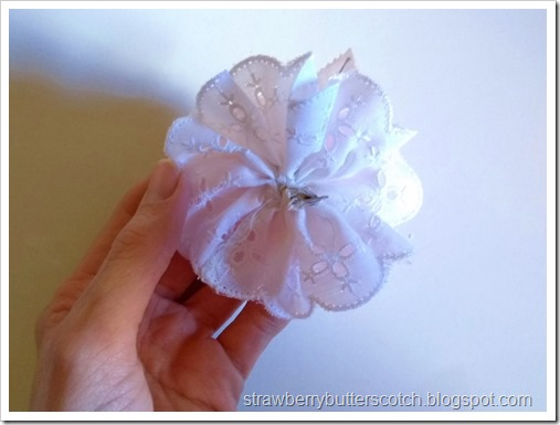 Making a flower and lace headband.  Add the flower to the lace rossette.