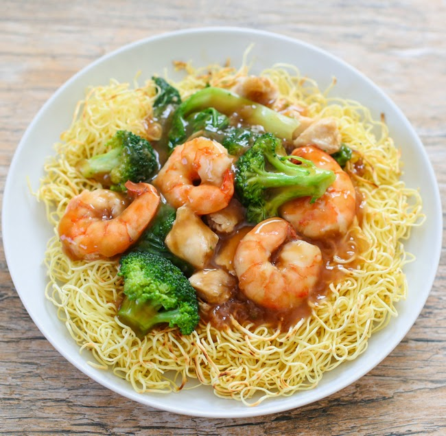 a top-down photo of pan-fried noodles with shrimp and broccoli