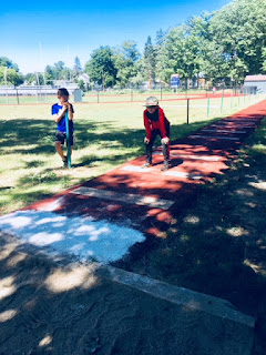 Two athlete preparing for long jump practice