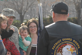 Photo: 1st Lt. Kyle Weisinger, returning OMLT member, daughters and wife talk with a Patriot Guard member.  The twelve Soldiers making up the Operational Mentoring Liaison Team (OMLT) from the Minnesota Army National Guard returned to Minnesota from a one-year deployment to Afghanistan in support of Operation Enduring Freedom on Nov. 6.