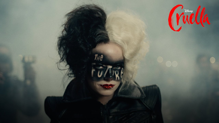 """Cruella teaser image with the words """"The Future"""" painted across her face"""