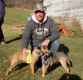 Dan with Mardi and Banks at an Earth Dog trial in Iowa.